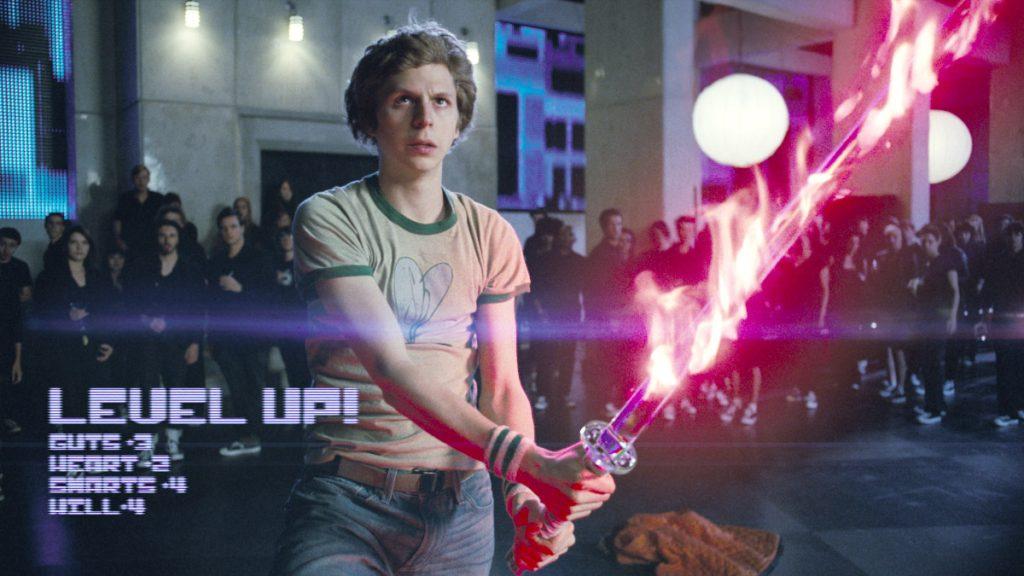 Fotograma de la película Scott Pilgrim vs The World donde aparecen mezclados elementos tradicionales del videojuego, subidas de nivel y reparto de puntos de habilidad, en la propia película.